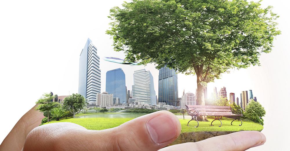 Grön stad i en hand