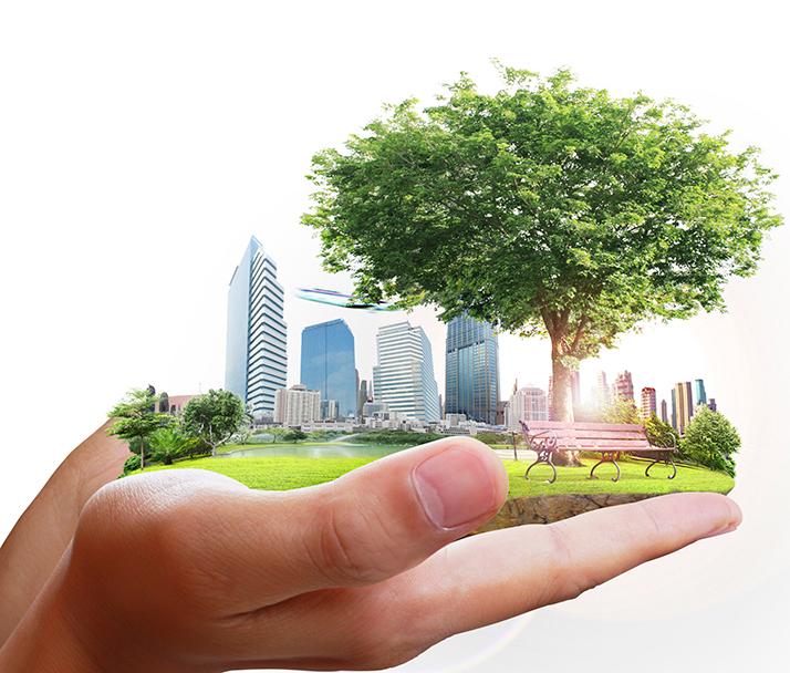 Grön hållbar stad i en hand